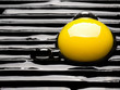 close up of a raw egg on a grill