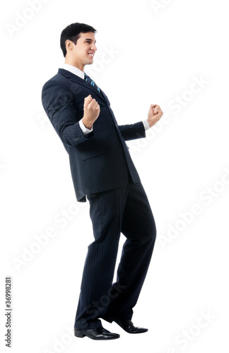 Very happy successful gesturing businessman