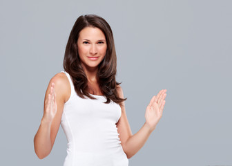 Young woman shows large size with hands