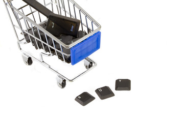 """Shopping cart with computer keys showing """"buy"""""""