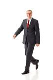 Senior business man, walking
