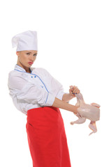 woman- cook  put her hand to raw chicken