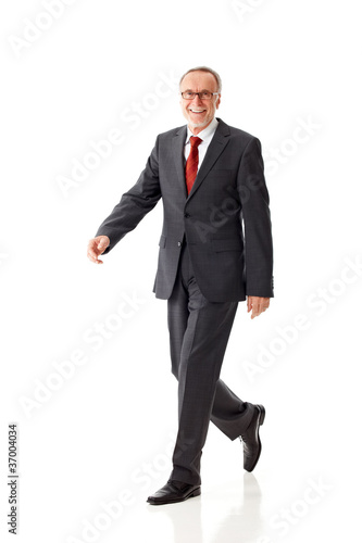 Senior business man, walking
