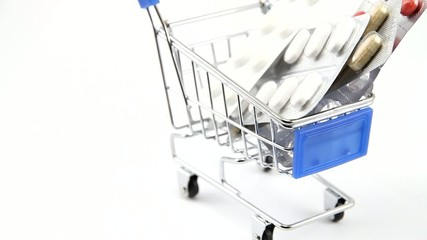 Shopping cart with assorted medical pills rotating