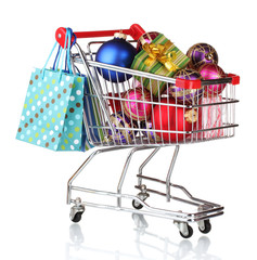 Beautiful bright Christmas balls and gifts in the cart and bags