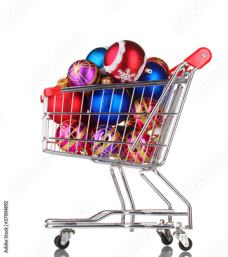 Beautiful bright Christmas balls in the cart isolated on white