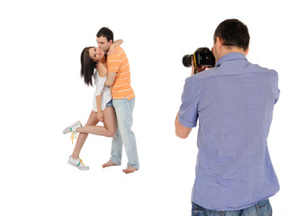 professional male photographer making family picture at studio.
