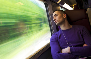 Portrait of a young handsome man in the train