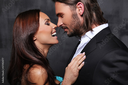 Close-up portrait of sexy caucasian young smiling couple