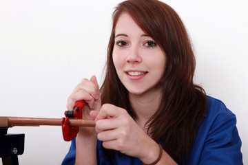 portrait of a young woman plumbing