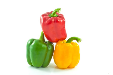 Red, yellow and green bell peppers isolated on the white backgro