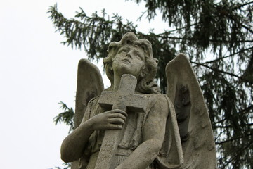 Sculpture of angel with cross