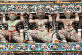 Giant statues around the Chedi of Wat Arun in Bangkok city poster