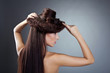 Cute naked woman posing with hair style hat