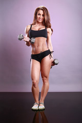 Fitness model's dumbbell routine