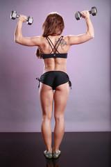 Fitness model's dumbbell routine