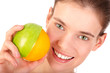 Smiling girl with half an apple and half an orange