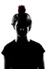 one young teenager boy or girl silhouette with an apple on his h