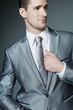Handsome businessman in silver suit.