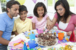 Asian Indian Family Celebrating Birthday Party Cutting the Cake
