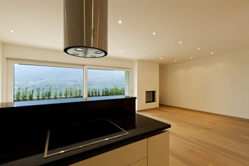 large room with kitchen island, window view