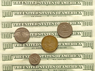 USA dollar banknotes and coins.