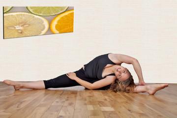 Flexible woman demonstrating yoga positions