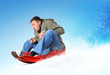 Young man flies on sled in the snow, concept