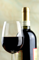Glass and bottle of fine Italian red wine, closeup