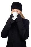 Blonde woman drinking something hot