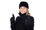 Blonde woman with a black coat saying Ok