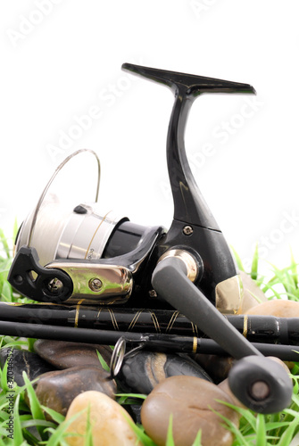 Fishing Reel on Rocks and Grass