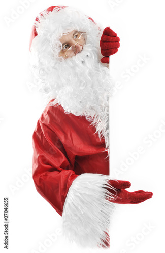 Santa Claus on white holding blank sign