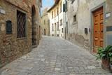 narrow italian street in tuscan borgo Montefioralle