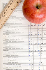 Apple and ruler on a report card