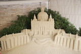 sand replica of church poster