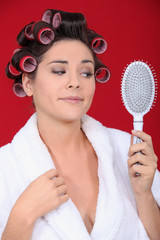 Young woman with her hair in rollers