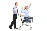 Person pushing a happy woman in a shopping cart