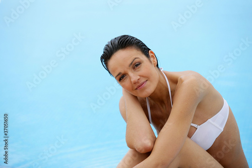 Woman relaxing at a poolside