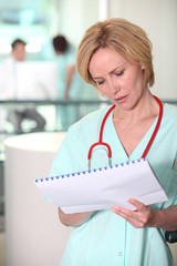 Female nurse with patients chart