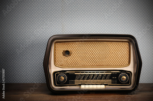 Leinwandbild Motiv antique radio on vintage background