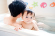 baby and father in bath