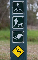 Sign on park regulations, restriction and warnings.