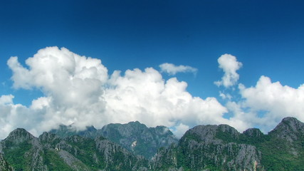 Clouds over mountains time lapse