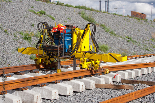 Railroad track construction machine