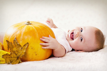 Laughing Baby and a Pumpkin