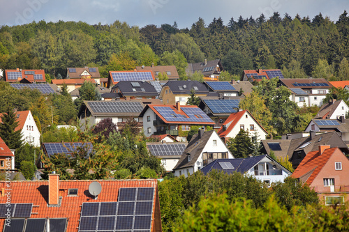 view on houses with solar thermal and photovoltaik roof systems - 37055614