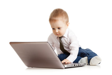 Cute child using laptop