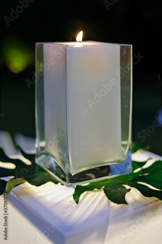 A wedding reception decorated with candles