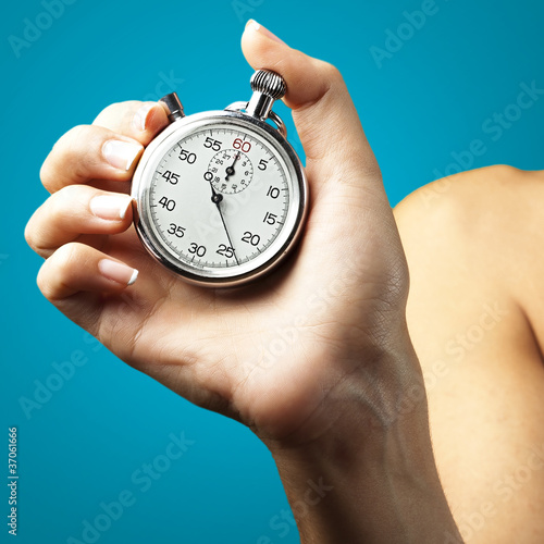 woman pushing stopwatch